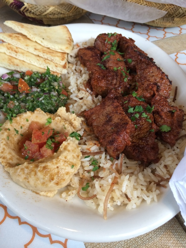 Shish Kabob - Beef with rice pilaf, hummus, tabouleh and arabic bread This is Mom's plate