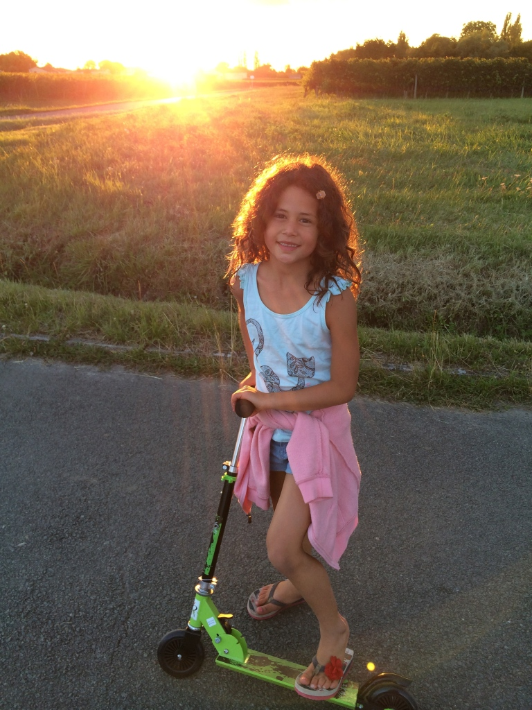 Riding her scooter around the vineyards, watching the sunset :)