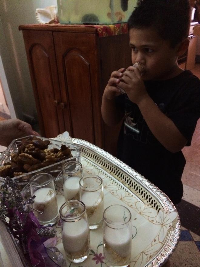 Jaf getting his first taste of milk with orange blossom :)