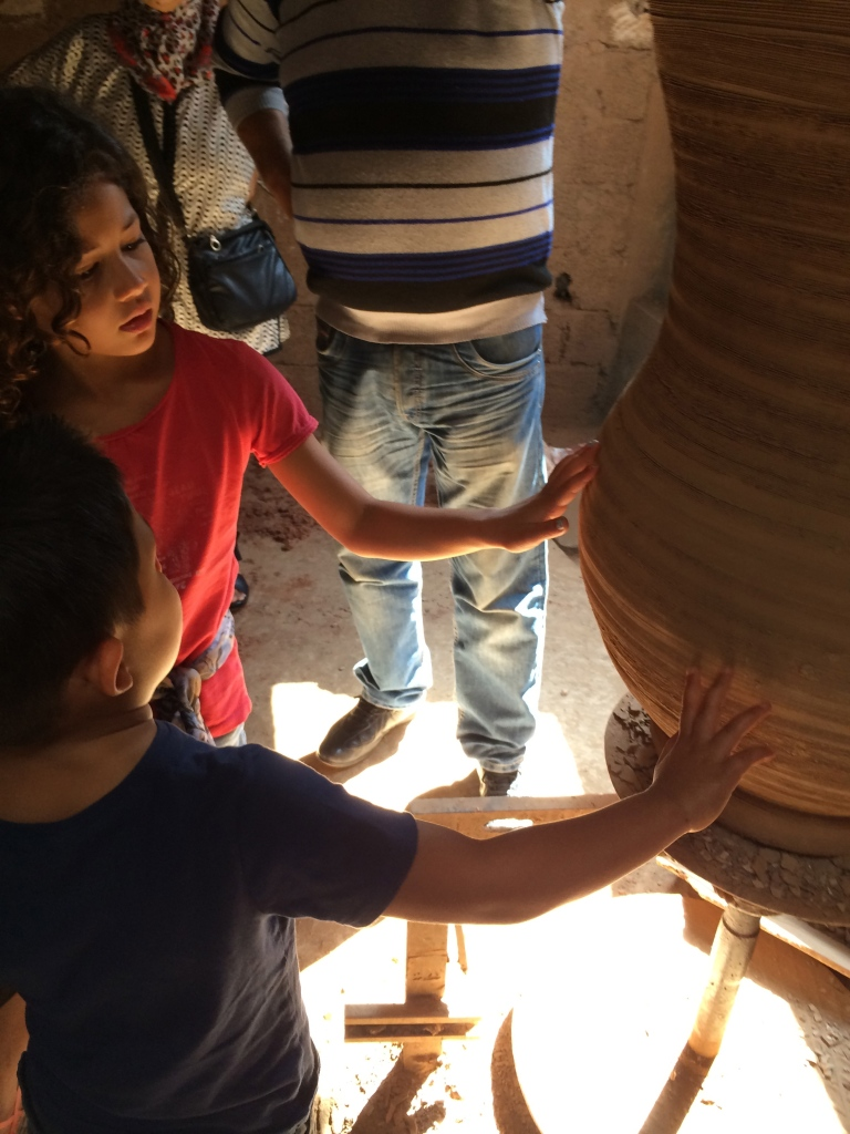 Explaining how this large pot is put together.