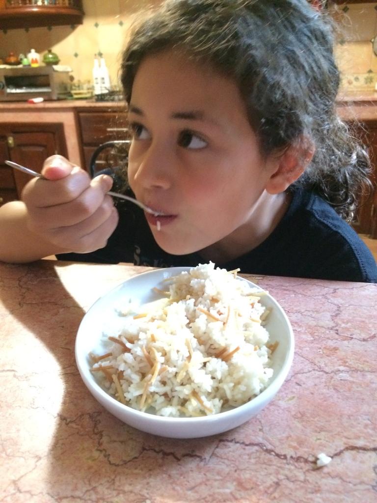 Enjoying her rice!