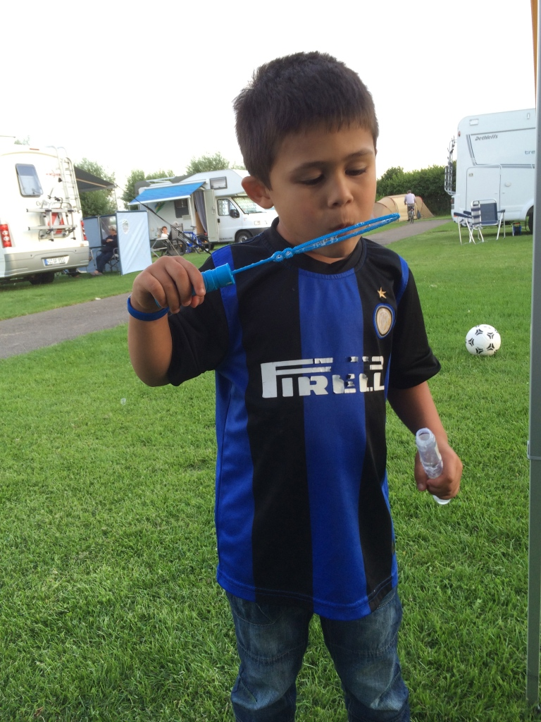 Blowing bubbles and playing soccer at a campsite in Edam, Netherlands… It was 8pm!